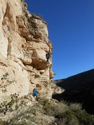 Chris hitting almost out of the crux of the route.