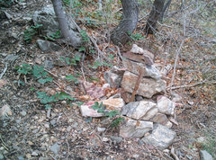 This cairn marks the place on the trail where you should head up and left when approaching the wall..