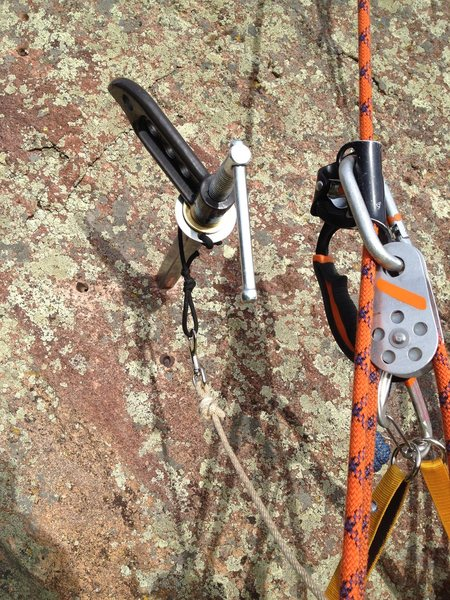 Rock Climbing Photo: Extracting the wedge bolt (3rd, and highest, on th...