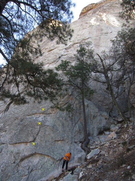 Start of route marked w stick and the 1st 3 bolts.  <br> (Lin about to do Earth Angel.)