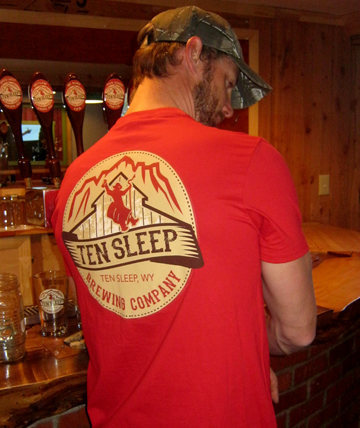 Ten Sleep Brewing Co. tap room, featuring one of the owner's in a logo t-shirt.
