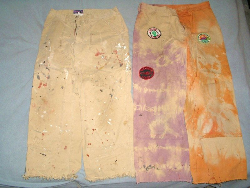 Last remaining pairs of my old canvas pants. One used for house painting now days,,and the other was my own RIT dye job on stove at home,, originally in very bright  orange and purple color back then.