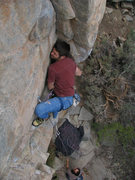 Rock Climbing Photo: JN in the thick of the mantel crux.