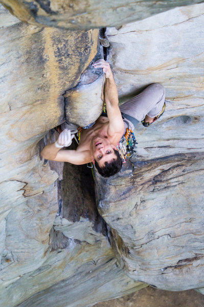Warren Whipple leading Stuck In Another Dimension (11a) at Junkyard Wall. Photo by Jeff Dunbar.