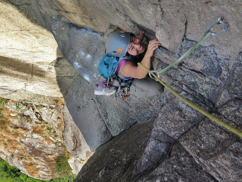 Ivana on the 5 pitch 10a, Gweilo. Lion Rock.
