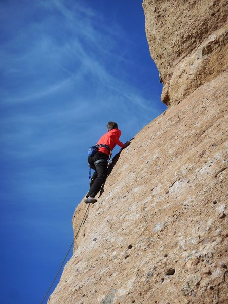 """Climber making the final moves to the anchor on """"Slotterhouse."""""""