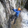 A climber working his way up the crack in the first third of the route.