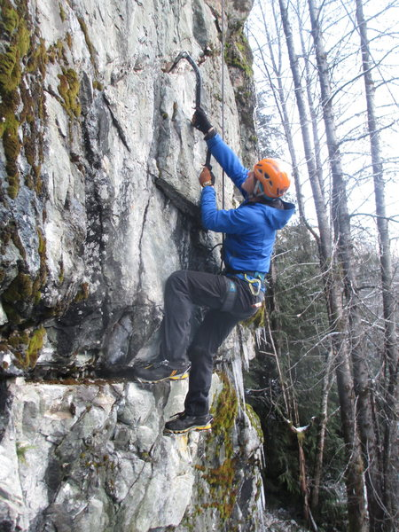 A climber moving through the thin top section of the climb.