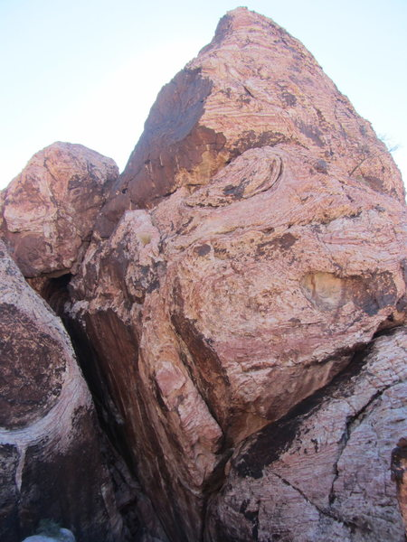 A couple cairns will bring you under this formation, which has a slot at its base (The Crevasse).