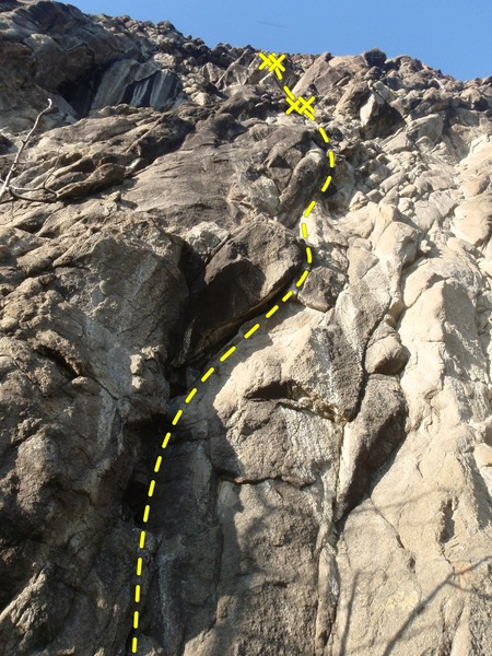 Climb the bolted crack to gain a two bolt anchor.