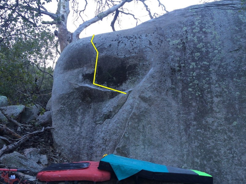 Left side of boulder is Mind On Fire