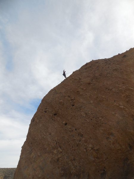 """Making the descent off the """"Zona Rosa Wall"""" on the Hatchery formation at Texas Canyon."""