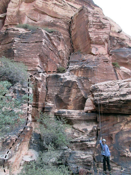 The business is all too obvious. Approach via easier climbing.