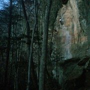 Jade Kroening cleaning the route in the dark.