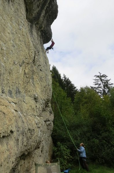 Pulling the roof on good holds.  The redpoint crux lies above.