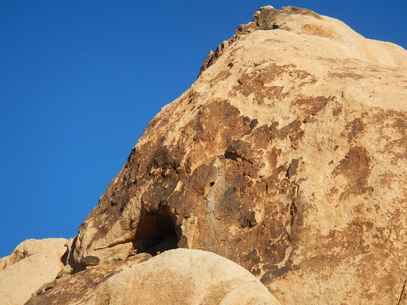 A close-up of the top face.  Crumbly rock with no pro..... what's not to like?