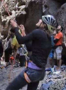 Belayer lifted, brake hand above device, at 1:23.