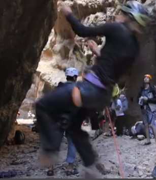 Belayer lifted, brake hand above device, at 1:24