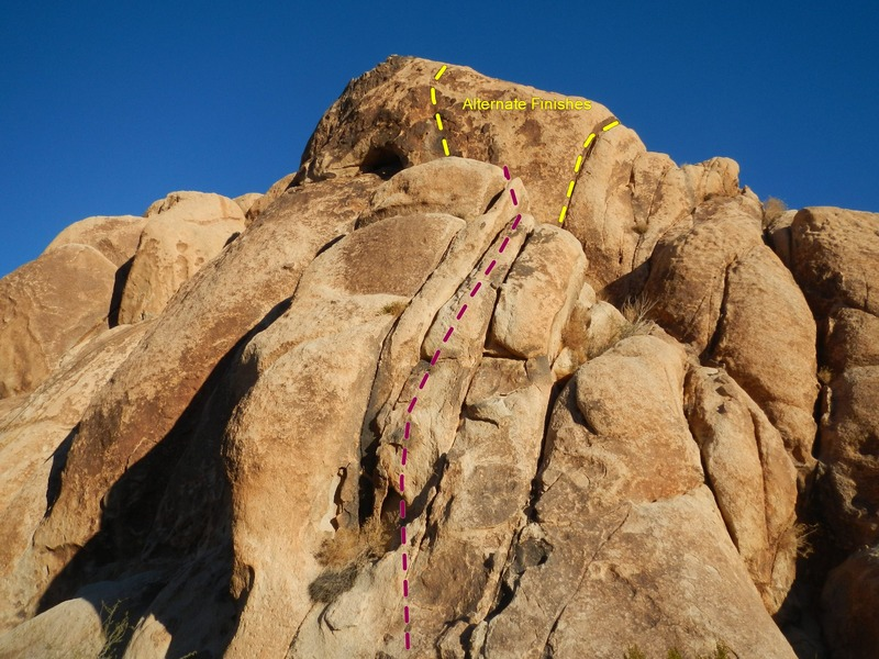 Climb the cracks any way you want and finish up with fractured face climbing on unprotectable terrain or harder cracks to the right.