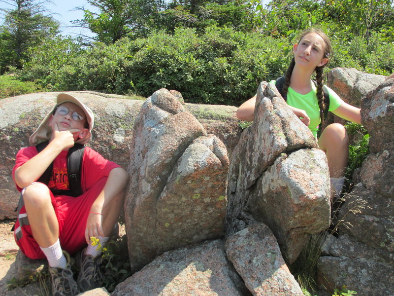 "This photo is the cover page of, ROCK FRIENDS OF ACADIA - a Treasure Hunt for Children and Adults, 2015 written by our friend Ellen Dohman who lives next to Acadia National Park. Zachary and Alexa are imitating these two rock friends, ""the codgers"" as they sit there contemplating the weather for the day. You can purchase a copy of this book at Sherman's Book Store in Bar Harbor Maine."