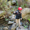 Bryson Fienup crosses San Ysidro creek, at the foot of the main climbing wall.