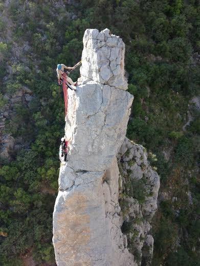 Alipio Loyola belaying Bruna Kajiya on the summit of the Western Spire