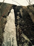 Climb up thin line of ice. Follow the crack to a second patch on the right and top out.