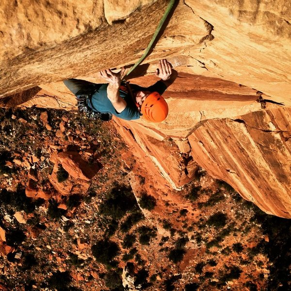 """trying hard not to blow it on the """"grip tape"""" slopers atop Pitch 4. Photo by C. Niggemyer"""