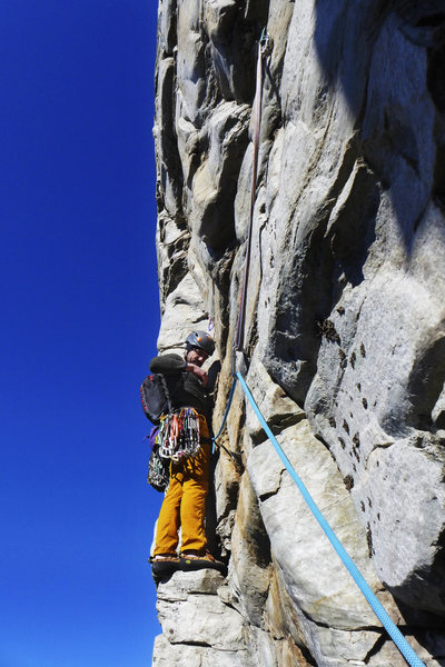 Level view of traverse for accurate perspective on past-vertical face above. Crux starts from very solid stance