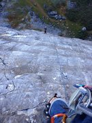 looking down at belayer over the waves of rock on the 2nd pitch of Roman Holiday