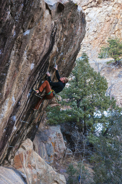 Spencer working the upper crux.