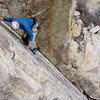 Doug searching for the next foothold on 'Uptown Girl' 5.9