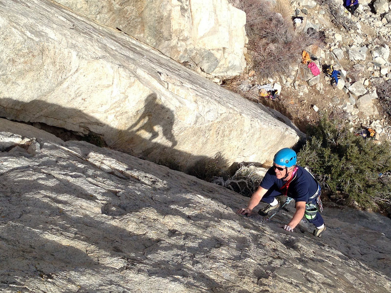 Mike sampling the smooth features of 'Downtown Man' (5.7).<br> <br> His shadow seems to be more interested in 'Uptown Funk,' the 5.8+ arete in the background.<br> <br>