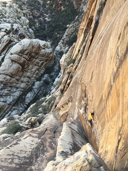 Brad G. follows the crux arete.