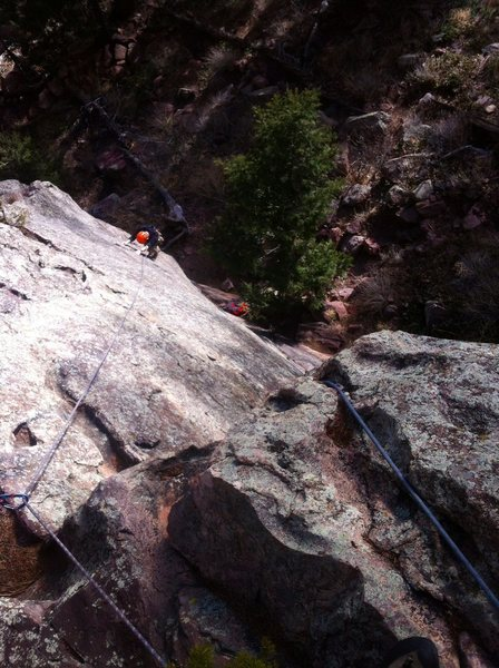 Brian mid-traverse on Baby Sitter (5.9 PG-13). Note double ropes to prevent a nasty follower fall.