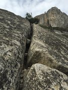 Rock Climbing Photo: Looking up the last pitch, with a view of Lost Arr...