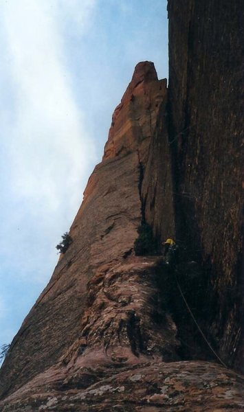 This is about a pitch after the rappel/pendulum. Up to an offwidth/squeeze with some hand sizes up a bit and kind of deep back in. Then pops up into 30ish feet of a nice handcrack seen in the face. The route continues in the steep gully right of the buttress above.