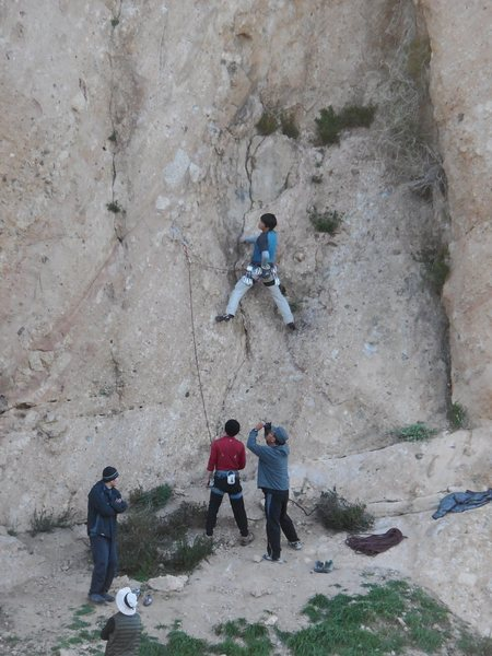 """Climber sifting through the initial choss and friable holds on """"Black Gold.""""<br> The rock and the moves get better after climbing above the first couple bolts."""