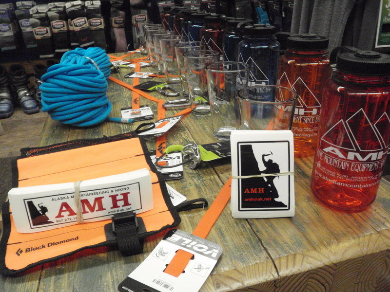 Alaska Mountaineering And Hiking has donated this table full of prizes to be given away at the Valdez Ice Fest!! We have Edelride locking biners, Megajul belay devices, Nalgene bottles, AMH pint glasses, Voile gear straps, Black Diamond Ice ScrewUp, and the grand prize a Beal Joker climbing rope!!! Along with prizes they will be running specials on ice climbing rental gear for the festival weekend. 36$ for boots, Crampons, and a Helmet package Feb 12th – 17th!! Check them out at 2633 Spenard Rd, in Anchorage.<br> AMH You guys are amazing!!!