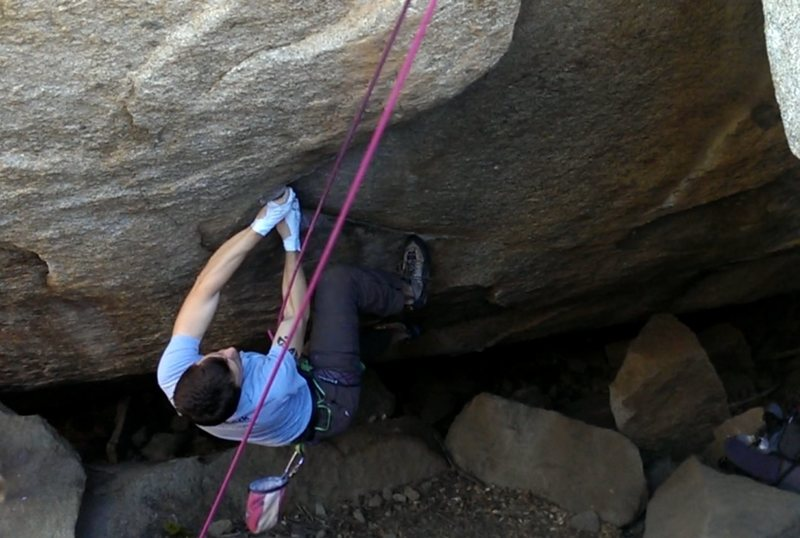 KC cruising through the opening sequence.<br> <br> Route follows the obvious jugs up and then over the fun mantle to the top.  Chockstone giant boulder on the right is off!