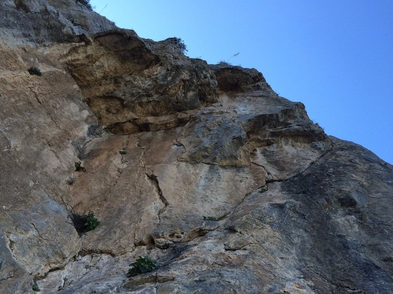 Looking up at crux roof on pitch 4