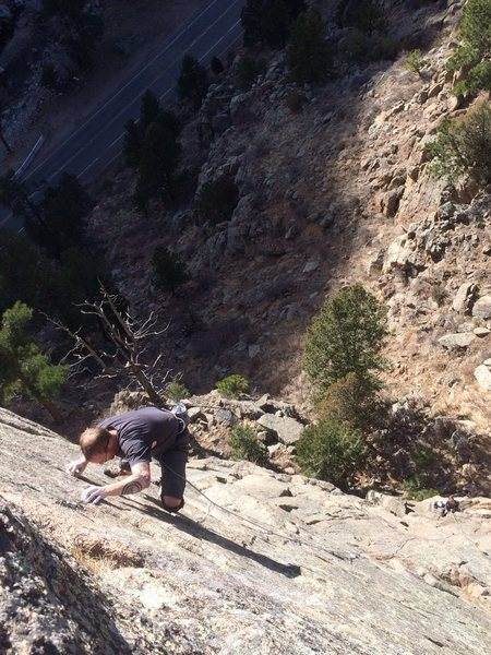 Getting to the last clip on Upside the Cranium. Stellar face climb in the St.Vrain.