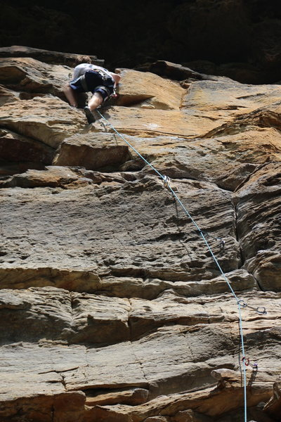 Rock Climbing Photo: Climber pulling up to the anchors