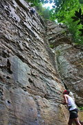Rock Climbing Photo: Belayer observes as climber leads the final moves