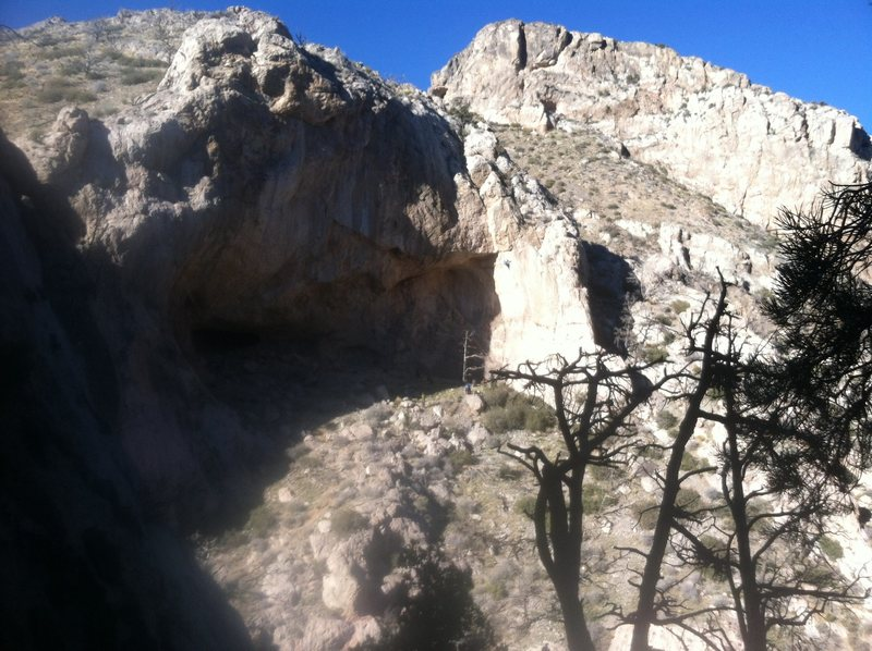 """A climber on """"fun pig"""" 13a in the sun on the right side of sunset cave"""