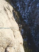 Rock Climbing Photo: Chris Norwood making the final moves at the top of...