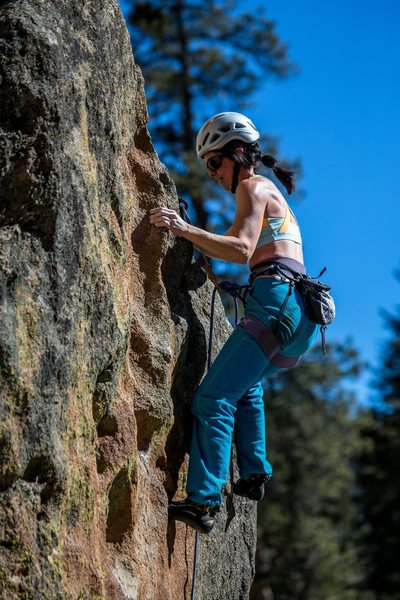 Pinching the neat tufa-like pinch at the top of the difficulties and before the slabby finish. February 2015. Aaron Lovato photo.