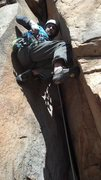 Rock Climbing Photo: Wedged in the chimney about to place some pro.  I ...