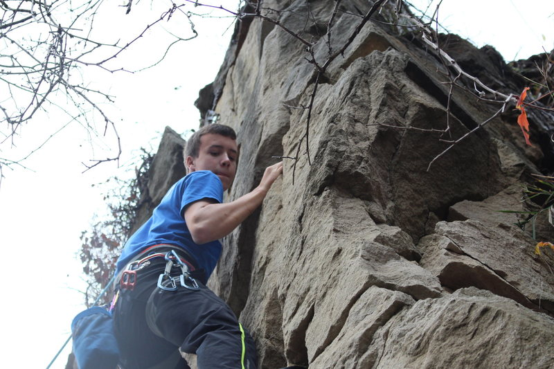 Moving up towards the end of the big crack, near the right arete.