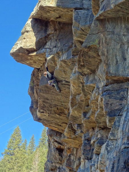 Liz moving fluidly through the crux roof.